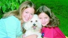 Owner Roger McCoy's daughters and their dog Lucky (1993-07), a happy Pet DeFence dog for 14 yrs